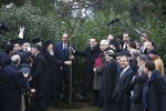 Greece's Prime Minister Alexis Tsipras, right, and Ecumenical Patriarch Bartholomew I, left, hold a tree during their visit at the Theological School of Halki, in Heybeli Island, near Istanbul, Wednesday, Feb. 6, 2019. The president of Turkey and the prime minister of Greece agreed Tuesday on the need to keep