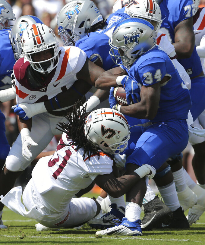 Middle Tennessee running back Amir Rasul (34) is tackled by Virginia Tech defensive back Nasir Peoples (31) in the first half of an NCAA college football game, Saturday, Sept. 11, 2021, in Blacksburg Va.  (AP Photo/Matt Gentry)