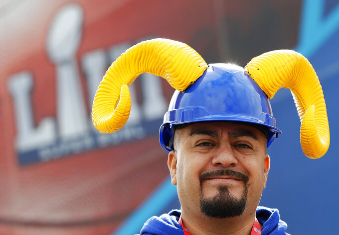 A Los Angeles Rams fan walks outside the Mercedes-Benz Stadium before the NFL Super Bowl 53 football game between the Los Angeles Rams and the New England Patriots, Sunday, Feb. 3, 2019, in Atlanta. (AP Photo/Mark Humphrey)