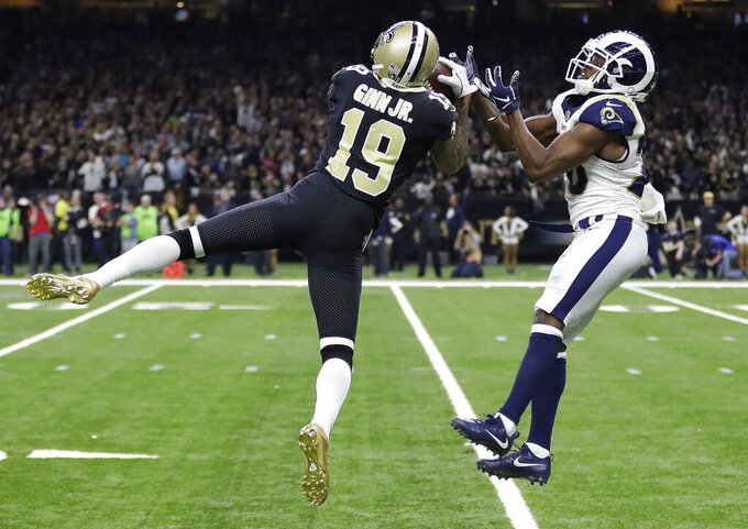 New Orleans Saints' Ted Ginn catches a pass in front of Los Angeles Rams' Lamarcus Joyner during the second half of the NFL football NFC championship game, Sunday, Jan. 20, 2019, in New Orleans. (AP Photo/David J. Phillip)
