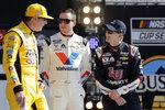 Kyle Busch, left, Alex Bowman, center, and William Byron talk during introductions before the NASCAR Busch Clash auto race at Daytona International Speedway, Sunday, Feb. 9, 2020, in Daytona Beach, Fla. (AP Photo/Terry Renna)