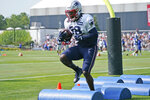New England Patriots running back Rhamondre Stevenson runs a drill during a joint NFL football practice with the New York Giants, Wednesday, Aug. 25, 2021, in Foxborough, Mass. (AP Photo/Steven Senne)