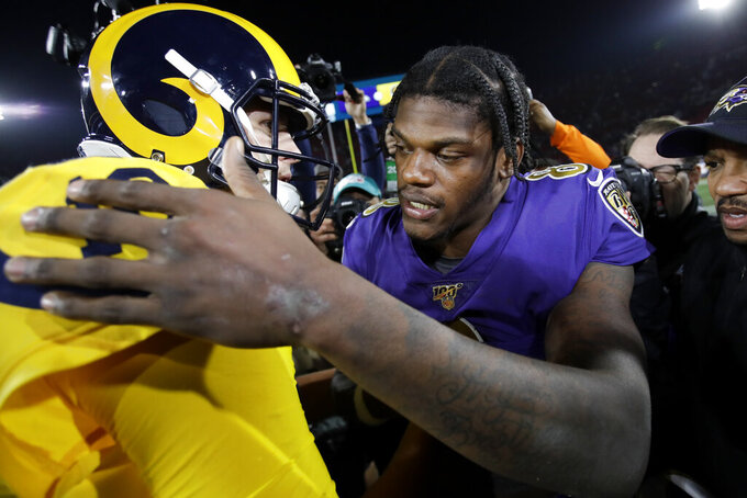 Baltimore Ravens quarterback Lamar Jackson hugs Los Angeles Rams quarterback Jared Goff after an NFL football game Monday, Nov. 25, 2019, in Los Angeles. (AP Photo/Marcio Jose Sanchez)