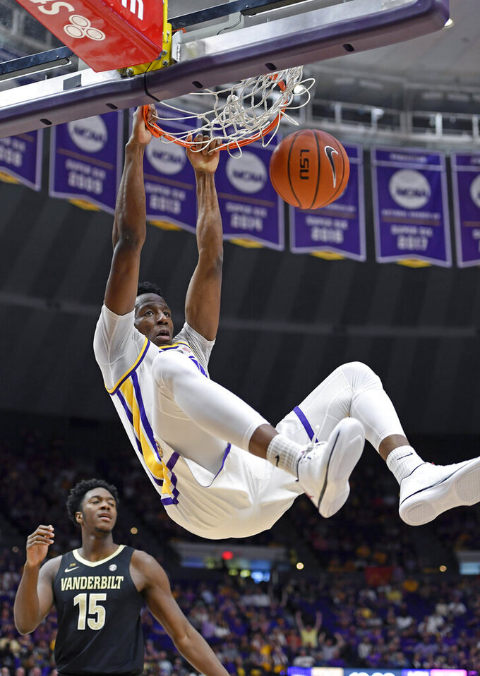LSU forward Kavell Bigby-Williams (11) dunks the ball in front of Vanderbilt forward Clevon Brown (15) in the first half of an NCAA college basketball game, Saturday, March 9, 2019, in Baton Rouge, La. (AP Photo/Bill Feig)