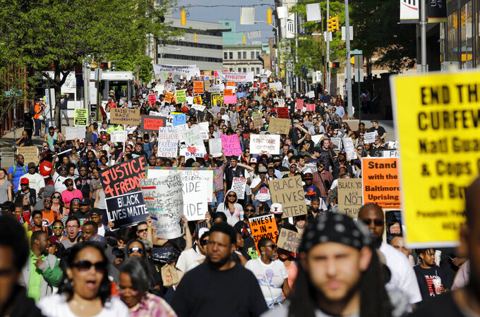 FILE - In this May 2, 2015, file photo, protesters march through Baltimore the day after charges were announced against the police officers involved in Freddie Gray's death. Black Lives Matter has gone mainstream — and black activists are carefully assessing how they should respond. Today, the movement boasts a following of millions across social media platforms. (AP Photo/Patrick Semansky, File)