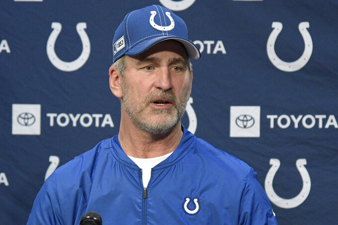 """FILE - In this Dec. 29, 2019, file photo, Indianapolis Colts head coach Frank Reich answers a question by a reporter during a news conference after an NFL football game against the Jacksonville Jaguars in Jacksonville, Fla. Teams can conduct classroom instruction and on-field activities through Zoom meetings or similar apps instead of at their facilities . They can meet virtually as much as four hours per day, four days per week. """"We are getting a ton done,"""" he says,""""with the technology today. """"(AP Photo/Phelan M. Ebenhack, File)"""