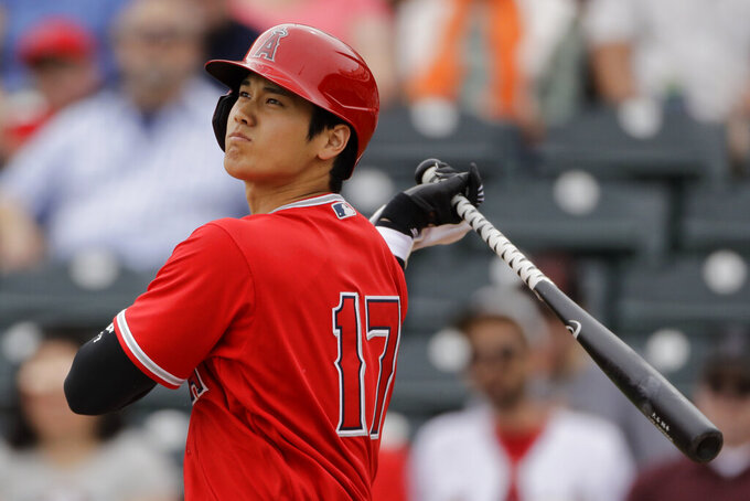 FILE - In this Feb. 28, 2020, file photo, Los Angeles Angels' Shohei Ohtani bats during the first inning of a spring training baseball game against the Texas Rangers, in Tempe, Ariz. (AP Photo/Charlie Riedel, File)