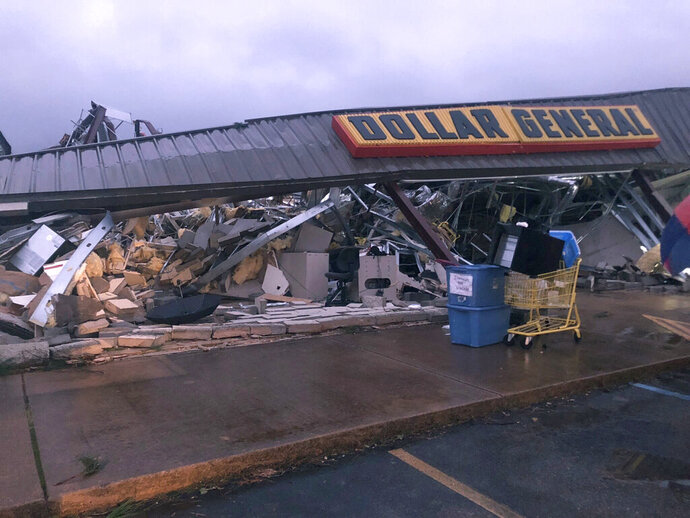 In this Tuesday, March 24, 2020 photo, a Dollar General store in Tishomingo, Miss., is completely destroyed after a suspected tornado swept through the area. (Kayla Thompson/WTVA via AP)