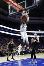 Villanova's Saddiq Bey (15) dunks the ball as Butler's Jordan Tucker (1) and Sean McDermott (22) look on during the first half of an NCAA college basketball game, Saturday, March 2, 2019, in Philadelphia. (AP Photo/Matt Slocum)