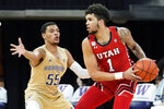 Utah forward Timmy Allen (1) tries to get around Washington guard Quade Green (55) during the first half of an NCAA college basketball game, Sunday, Jan. 24, 2021, in Seattle. (AP Photo/Ted S. Warren)