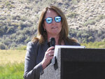U.S. Bureau of Reclamation Commissioner Brenda Burman speaks Wednesday, Sept. 11, 2019 at a ground-breaking ceremony for a $23.5 million fish passage project at the Truckee River's Derby Dam about 20 miles east of Reno, Nevada. The bureau is building a bypass canal with fish screens to help the threatened Lahontan cutthroat trout pass upstream to their native spawning grounds cutoff since the dam was built in 1905. Before that, they would migrate from Pyramid Lake in the high desert 120 miles upstream to spawn in Lake Tahoe. (AP Photo/Scott Sonner).