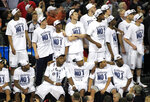 "FILE - In this April 4, 2011, file photo, Connecticut players watch the ""One Shining Moment"" video after the men's NCAA Final Four college basketball championship game against Butler in Houston. Connecticut won 53-41. Nearly everyone involved in the men's college basketball tournament, it seems, cherishes a ""One Shining Moment"" memory. (AP Photo/Mark Humphrey, File)"
