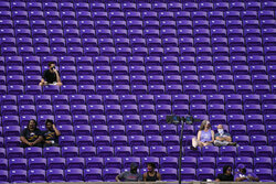 A limited number of fans sit social distanced due to COVID-19 concerns, in Dowdy Ficklen Stadium prior to an NCAA college football game between East Carolina and Central Florida in Greenville, N.C., Saturday, Sept. 26, 2020. (AP Photo/Gerry Broome)