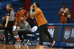 Texas coach Shaka Smart yells out plays to his players in the second half of an NCAA college basketball game against Kansas Saturday, Jan. 2. 2021, in Lawrence, Kan. (Evert Nelson/The Topeka Capital-Journal via AP)