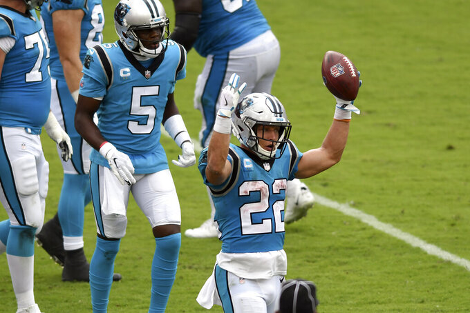 Carolina Panthers running back Christian McCaffrey (22) celebrates after scoring against the Tampa Bay Buccaneers during the second half of an NFL football game Sunday, Sept. 20, 2020, in Tampa, Fla. (AP Photo/Jason Behnken)