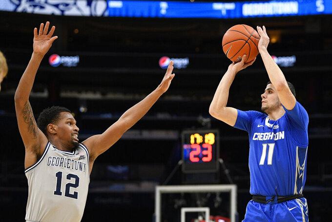 Creighton guard Marcus Zegarowski (11) shoots against Georgetown guard Terrell Allen (12) during the first half of an NCAA college basketball game, Wednesday, Jan. 15, 2020, in Washington. (AP Photo/Nick Wass)