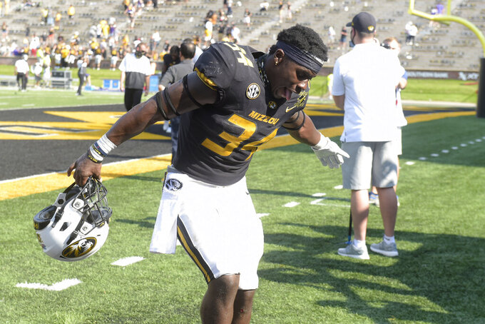 Missouri running back Larry Rountree III celebrates as he heads off the field following a 45-41 victory over LSU in an NCAA college football game Saturday, Oct. 10, 2020, in Columbia, Mo. (AP Photo/L.G. Patterson)