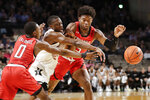 Vanderbilt guard Maxwell Evans, center, fights for the ball with Southeast Missouri State's Alex Caldwell (0) and Nygal Russell, right, in the first half of an NCAA college basketball game Wednesday, Nov. 6, 2019, in Nashville, Tenn. (AP Photo/Mark Humphrey)