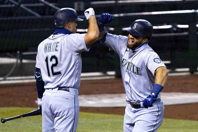 Seattle Mariners' Jose Marmolejos, right, celebrates his two-run home run against the Arizona Diamondbacks with Evan White during the fifth inning of a baseball game Saturday, Sept. 12, 2020, in Phoenix. (AP Photo/Ross D. Franklin)