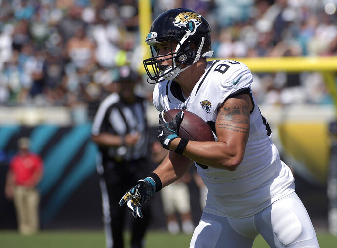 FILE - In this Sept. 30, 2018, file photo, Jacksonville Jaguars tight end James O'Shaughnessy (80) runs after catching a pass during the first half of an NFL football game against the New York Jets in Jacksonville, Fla. Veteran tight end has re-signed with the Jacksonville Jaguars, giving the team another option at one of its thinnest positions. (AP Photo/Phelan M. Ebenhack, File)