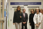First lady Melania Trump, left, walks with pediatrician Eileen Costello, front right, and U.S. Secretary of Health and Human Services Alex Azar, behind center left, during a visit to Boston Medical Center, in Boston, Wednesday, Nov. 6, 2019. The visit, part of the first lady's
