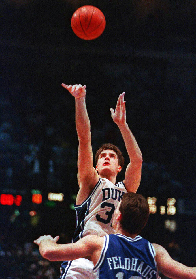 FILE - In this March 28, 1992, file photo, Duke's Christian Laettner takes the winning shot in overtime over Kentucky's Deron Feldhaus for a 104-103 victory in the East Regional final NCAA college basketball game in Philadelphia. (AP Photo/Charles Arbogast, File)