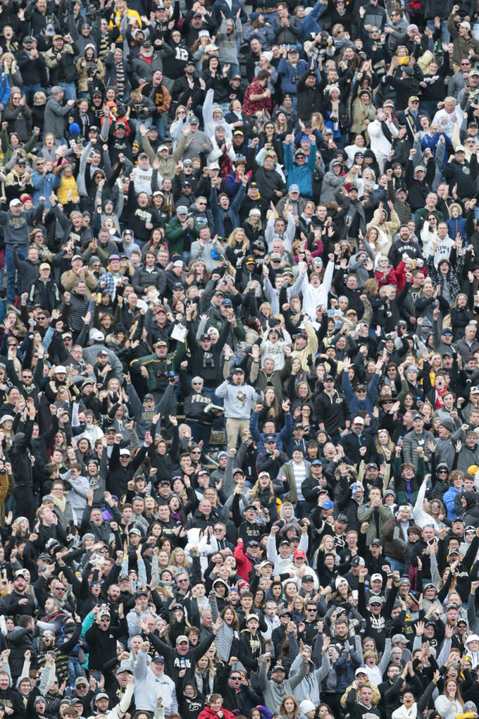 Purdue fans celebrate a touchdown against Iowa in the second half of an NCAA college football game in West Lafayette, Ind., Saturday, Nov. 3, 2018. (AP Photo/AJ Mast)