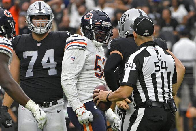 Chicago Bears outside linebacker Khalil Mack (52) reacts after sacking Las Vegas Raiders quarterback Derek Carr (4) during the first half of an NFL football game, Sunday, Oct. 10, 2021, in Las Vegas. (AP Photo/David Becker)