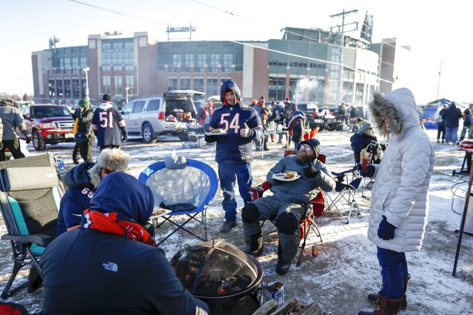 Fans tailgate outside Lambeau Field before an NFL football game between the Green Bay Packers and the Chicago Bears Sunday, Dec. 15, 2019, in Green Bay, Wis. (AP Photo/Matt Ludtke)