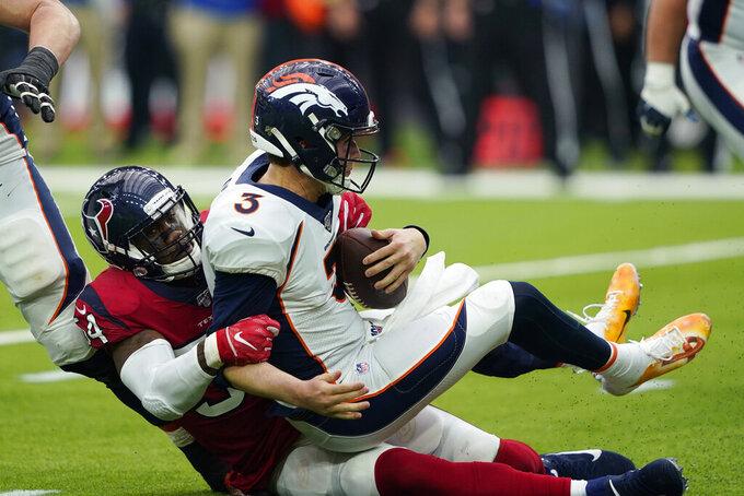 Denver Broncos quarterback Drew Lock (3) is sacked by Houston Texans linebacker Jake Martin (54) during the second half of an NFL football game Sunday, Dec. 8, 2019, in Houston. (AP Photo/David J. Phillip)