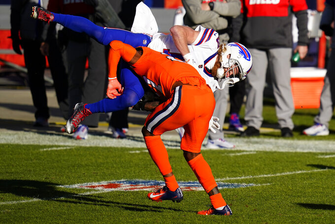 Denver Broncos safety Will Parks, below, hits Buffalo Bills wide receiver Cole Beasley, who misses the catch, during the first half of an NFL football game Saturday, Dec. 19, 2020, in Denver. (AP Photo/Jack Dempsey)
