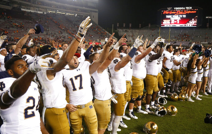 Notre Dame players celebrate a 45-23 win over Virginia Tech in an NCAA college football game in Blacksburg, Va., Saturday, Oct. 6, 2018. (AP Photo/Steve Helber)