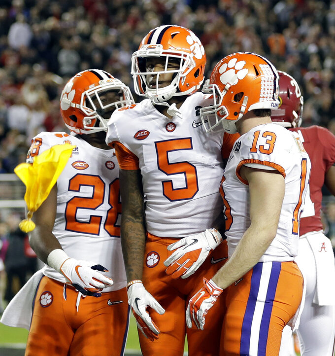Clemson's Tee Higgins celebrates his touchdown catch during the second half of the NCAA college football playoff championship game against Alabama, Monday, Jan. 7, 2019, in Santa Clara, Calif. (AP Photo/David J. Phillip)