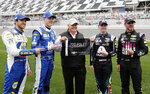 Team owner Rick Hendrick, center, celebrates his 700th pole award with drivers, from left, Chase Elliott, Alex Bowman, Hendrick, William Byron and Jimmie Johnson after qualifying for the Daytona 500 auto race at Daytona International Speedway, Sunday, Feb. 10, 2019, in Daytona Beach, Fla. (AP Photo/Terry Renna)