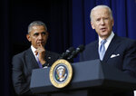 """FILE - In this Dec. 13, 2016, file photo, President Barack Obama listens as Vice President Joe Biden speaks in the South Court Auditorium in the Eisenhower Executive Office Building on the White House complex in Washington. Biden is getting some help from Obama as he looks to fill his campaign coffers and unify the Democratic party ahead of the November election. Obama and Biden will appear together Tuesday, June 23, for a """"virtual grassroots fundraiser,"""" the former vice president announced on Twitter. (AP Photo/Carolyn Kaster, File)"""