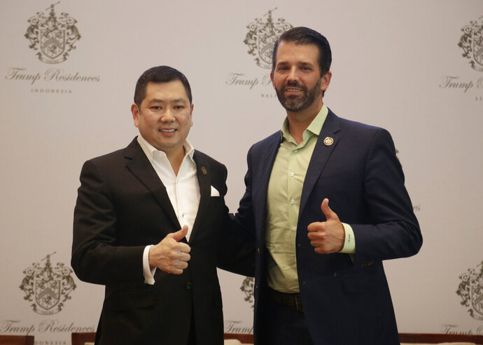 Donald Trump Jr., right, son of U.S. President Donald Trump, and Media Nusantara Citra (MNC) Group President and CEO Hary Tanoesoedibjo give thumb up sign as they pose for photographers during a press conference in Jakarta, Indonesia, Tuesday, Aug. 13, 2019. U.S. President Trump's son and his Indonesian business partner say a theme park that also features a Trump hotel and condos will no longer have Chinese financing. (AP Photo/Fadlan Syam)