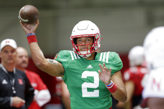 In this photo taken Aug. 7, 2019, Nebraska quarterback Adrian Martinez (2) throws during NCAA college football preseason practice in Lincoln, Neb. Martinez, the most productive freshman quarterback in the nation last season, averaged 371 yards of total offense against West Division opponents and 295 overall. He led an offense that ranked second in the Big Ten and scored 30 points per game. (AP Photo/Nati Harnik)