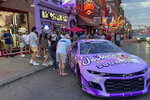 The No. 99 Chevrolet driven by Daniel Suarez for Trackhouse Racing is displayed outside Tootsie's Orchid Lounge in Nashville, Tenn., Thursday, June 17, 2021. Trackhouse hopes to be operating from downtown Nashville by 2023 and Marks is using Sunday's first Cup race in the market in 37 years to lay the groundwork for his move. (AP Photo/Jenna Fryer)