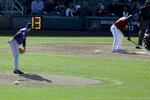 A pitch clock counts down as Colorado Rockies pitcher Chi Ci Gonzalez prepares the throw to Arizona Diamondbacks' Ildemaro Vargas during a spring baseball game in Scottsdale, Ariz., Saturday, Feb. 23, 2019. (AP Photo/Chris Carlson)