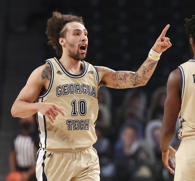 Georgia Tech guard Jose Alvarado reacts after hitting a three pointer against North Carolina during an NCAA college basketball game Wednesday, Dec. 30, 2020, in Atlanta. (Curtis Compton/Atlanta Journal-Constitution via AP, Pool)