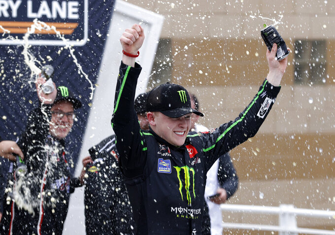 Ty Gibbs celebrates after winning an Xfinity Series auto race at Kansas Speedway in Kansas City, Kan., Saturday, Oct. 23, 2021. (AP Photo/Colin E. Braley)