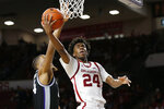 Oklahoma guard Jamal Bieniemy (24) shoots in front of Kansas State forward Levi Stockard III, left, in the second half of an NCAA college basketball game in Norman, Okla., Saturday, Jan. 4, 2020. (AP Photo/Sue Ogrocki)