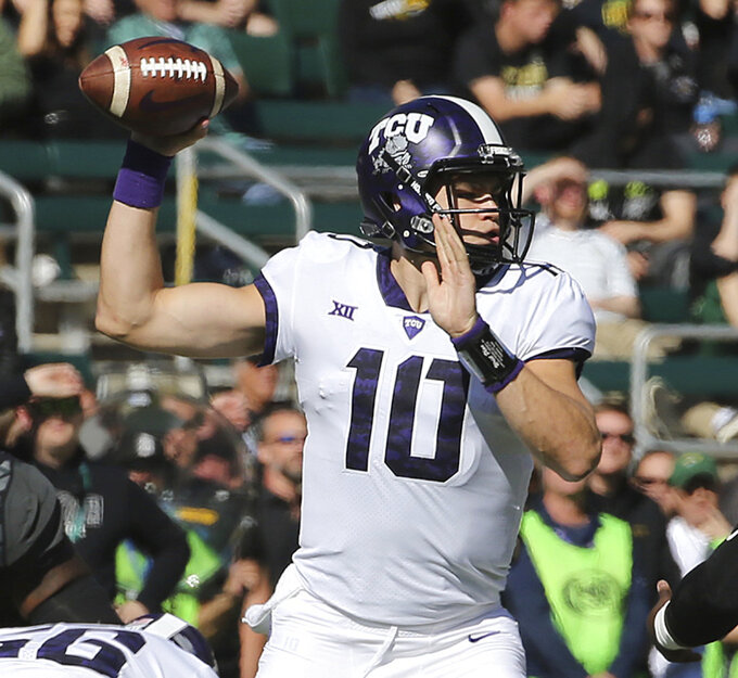 TCU quarterback Michael Collins (10) drops back to pass against Baylor in the first half of an NCAA college football game against Baylor, Saturday, Nov. 17, 2018, in Waco, Texas. (Jerry Larson/Waco Tribune-Herald via AP)