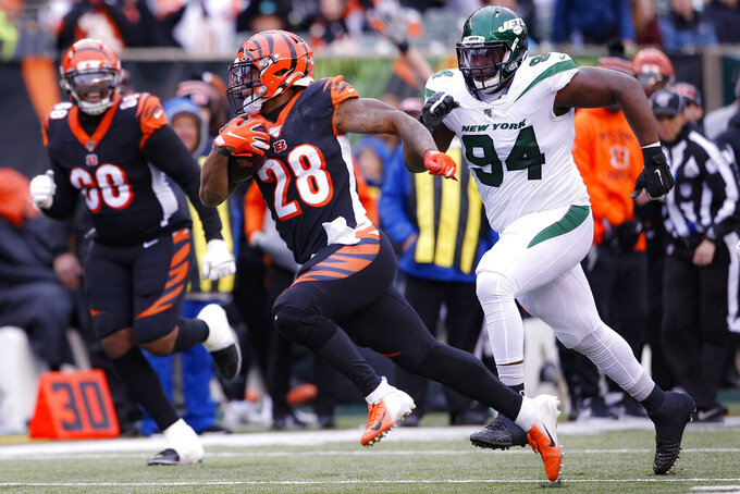 Cincinnati Bengals running back Joe Mixon (28) runs past New York Jets defensive tackle Foley Fatukasi (94) during the second half of an NFL football game, Sunday, Dec. 1, 2019, in Cincinnati. (AP Photo/Gary Landers)