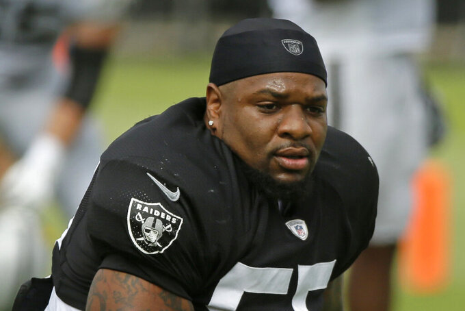 FILE - In this July 29, 2019, file photo, Oakland Raiders linebacker Vontaze Burfict attends NFL football training camp in Napa, Calif. Oakland defensive coordinator Paul Guenther lashed out at the NFL for the severe suspension the league handed Burfict for his latest infraction for a helmet-to-helmet hit. (AP Photo/Eric Risberg, File)
