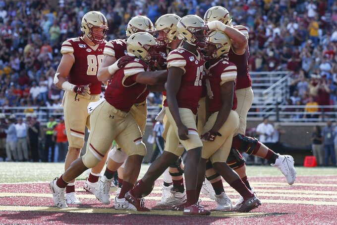 Boston College wide receiver Zay Flowers (4) celebrates his touchdown with teammates during the first half of an NCAA college football game against Virginia Tech in Boston, Saturday, Aug. 31, 2019. (AP Photo/Michael Dwyer)