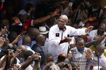 Defeated Congo opposition candidate Martin Fayulu greets supporters as he arrives at a rally in Kinshasha, Congo, Friday, Jan. 11, 2019. Fayulu announced on Friday he will file a court challenge to the presidential election results, while his opposition coalition asserted he actually received 61 percent of the vote according to the findings of the influential Catholic Church's observers.(AP Photo/Jerome Delay)