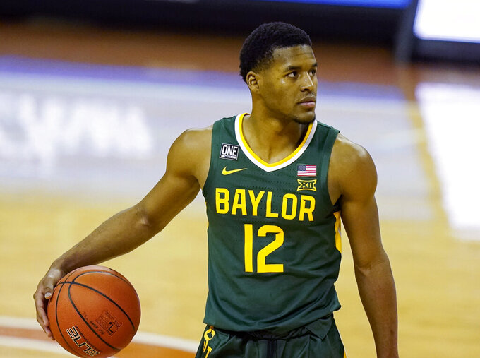 FILE - In this Feb. 2, 2021, file photo, Baylor guard Jared Butler controls the ball during an NCAA college basketball game against Texas in Austin, Texas. Butler is The Associated Press Big 12 men's basketball player of the year and a member of the All-Big 12 first team, announced Tuesday, March 9, 2021.  (AP Photo/Eric Gay, File)