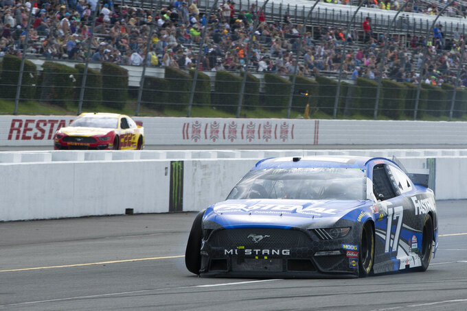 Ricky Stenhouse Jr. drives down pit road after wrecking during a NASCAR Cup Series auto race at Pocono Raceway, Sunday, June 2, 2019, in Long Pond, Pa. (AP Photo/Matt Slocum)
