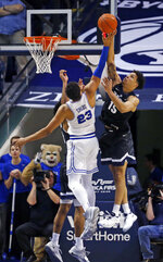 BYU forward Yoeli Childs (23) and Gonzaga forward Brandon Clarke (15) go up for a rebound during the first half of an NCAA college basketball game Thursday, Jan. 31, 2019, in Provo, Utah. (AP Photo/Rick Bowmer)